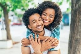 happy-african-american-couple-piggyback