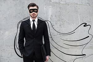 Man wearing a suit with a drawn cape on