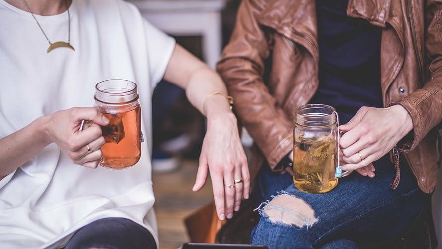 Single man and woman having drinks