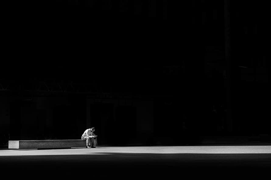 single and lonely man, sitting by himself in the dark.