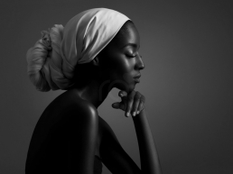 beautiful Black Woman with white head wrap thinking about her dating plight