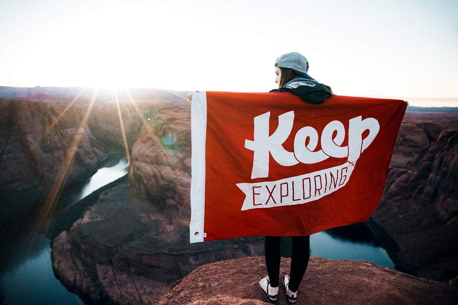 Dating Woman with flag that says keep exploring